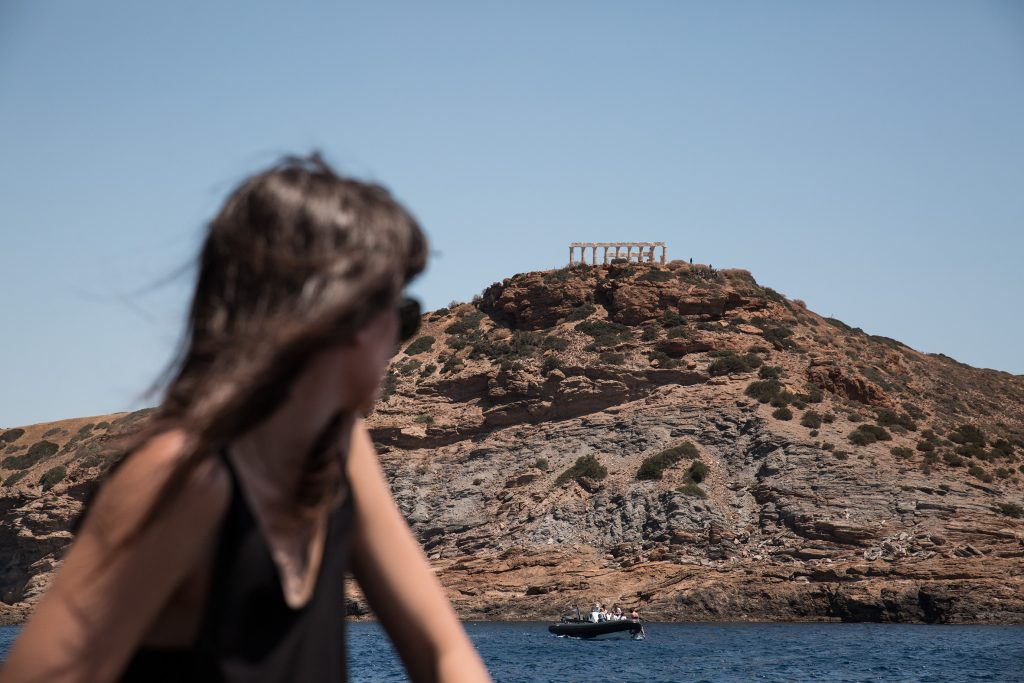 Girl looking at the temple of Poseidon during Terra Nation beach picnic